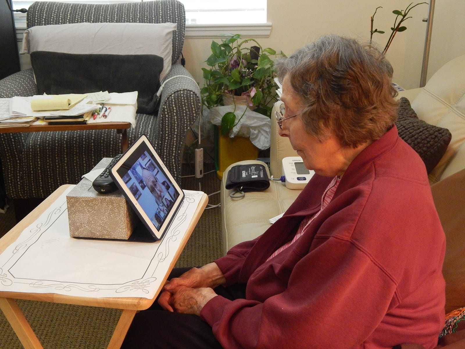 Medallion resident doing facetime on ipad