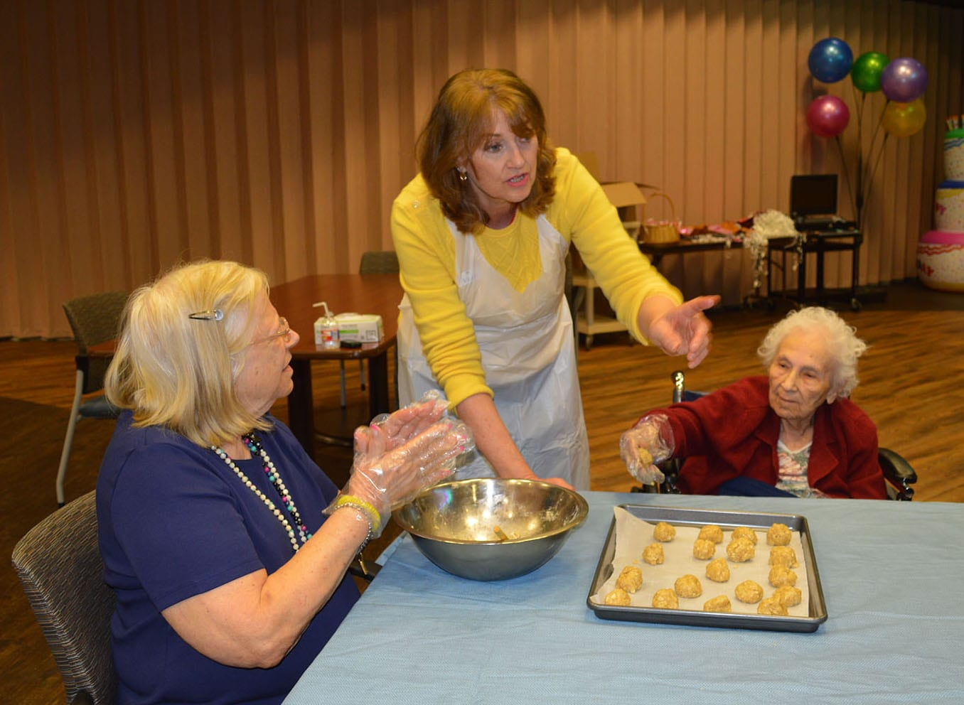 Volunteer leading cooking class with residents