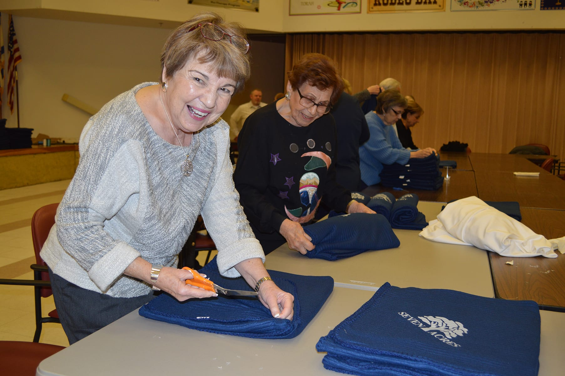 Volunteer wrapping Chanukah gifts for residents