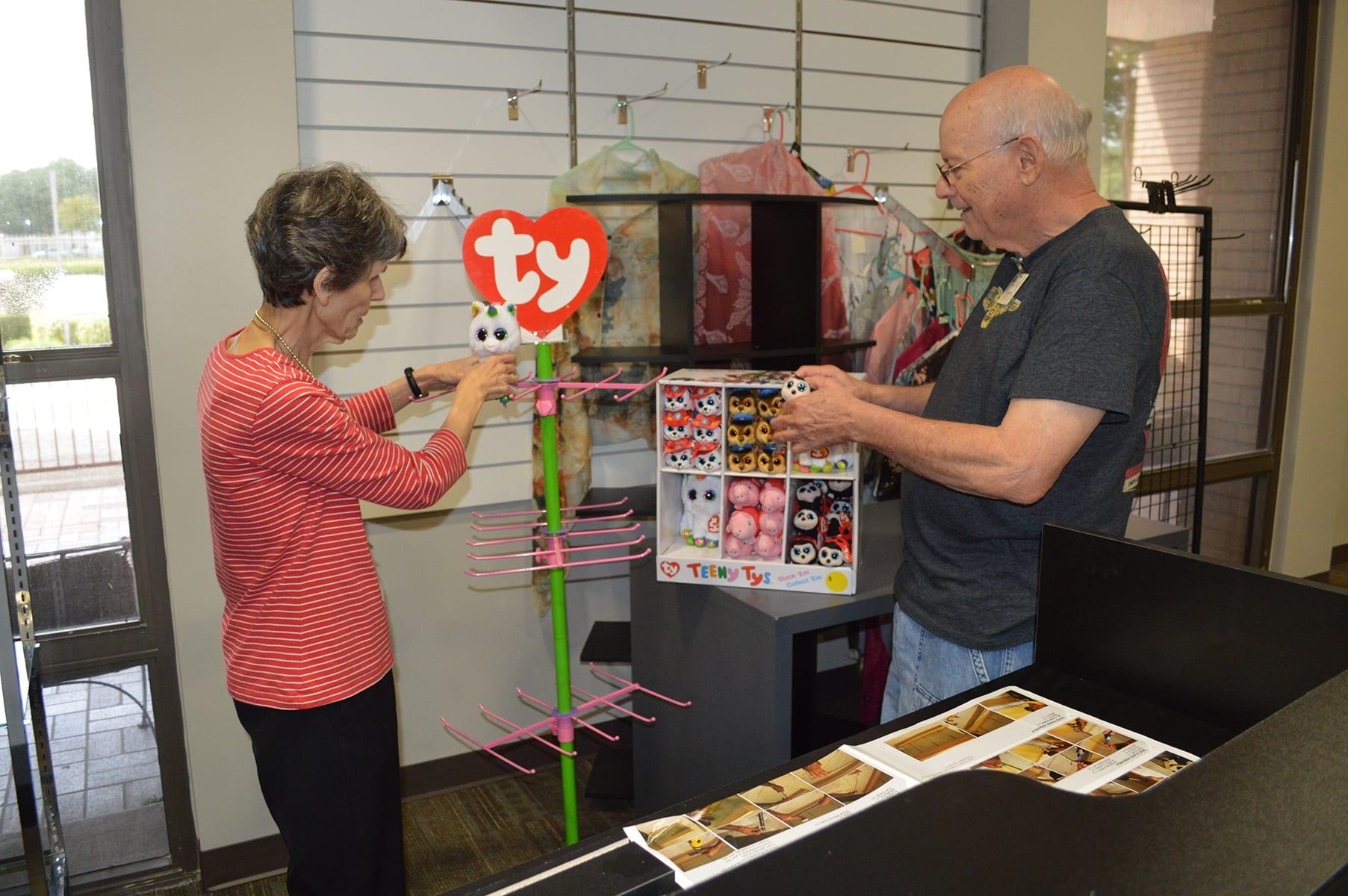 Volunteers working in the gift shop